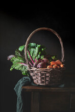 Still Life Of Wicker Basket With Handle Fulled Of Fresh Vegetables From Garden
