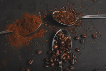 Types Of Coffee Grounds Instant, Powder And Coffee Beans In Spoons