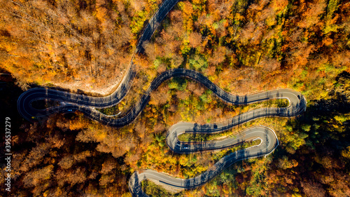 Fotografiet Drone's view Aerial landscape of road with traffic, rural road, autumn trees with yellow and orange leaves