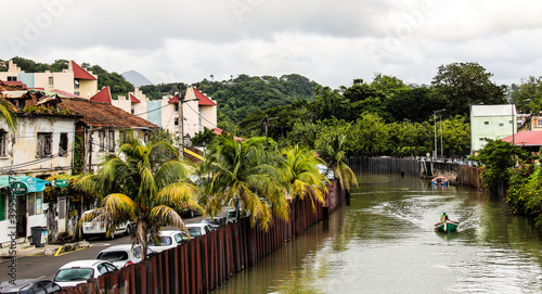 A motorboat cruises down one of Martinique's waterways Fototapet