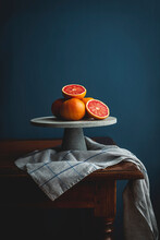Pink Grapefruits On A Cake Stand