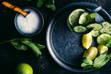 Sugar With Spoon On Dark Table, Mug Of Fresh Cucumber Detox Drink With Mint And Lime
