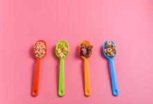 Various Breakfast Cereals On Plastic Spoons
