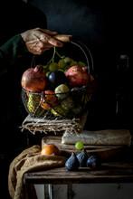 Crop Senior Person Taking Fruit From Basket