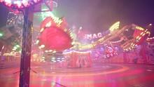 Illuminated Octopus Or Breakdance Ride In Speedy Movement At Amusement Park In Poland At Night - Medium Slider Shot