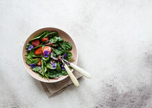 Fresh Summer Salad Of Spinach, Strawberries, Onions With Balsamic Vinegar And Edible Flowers