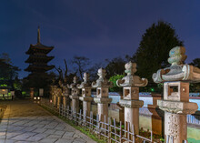 Stone Lanterns Along The Path Leading To The Ueno Tōshō-gū Shrine Classed As Important Cultural Property With The Five Storied Pagoda Of Kaneiji Temple At Night.