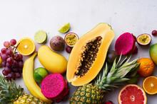 Tropical Fruits Flat Lay With Mango, Papaya, Pitahaya, Passion Fruit, Grapes, Limes And Pineapples