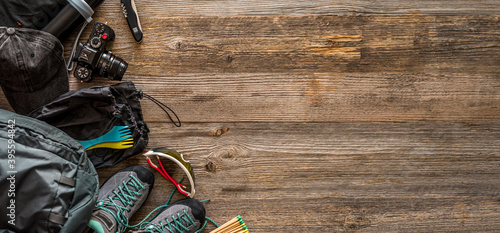 Trekking equipment on wooden background Fototapet