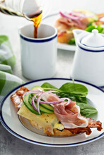 Breakfast Sandwich With Prosciutto, Avocado, Eggs And Bacon