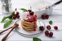 Pancakes With Vanilla Ice Cream, Cherry Jam And Cherries