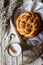 Cup Of Hot Cappuccino With Fresh Homemade Braided Bread