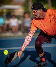 Digging Deep For A Low Pickleball Return By A Professional Pickleball Player