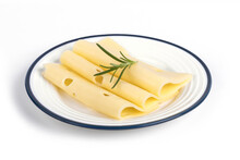 Closeup Of Swiss Cheese Slices With Rosemary On A Plate Isolated On A White Background