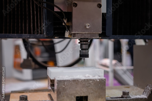 Tela Turning milling machine cutting white acrylic artificial stone workpiece at factory, exhibition: close up