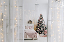 Stylish Christmas Tree In The Corner Of A Beautiful Bedroom Surrounded By Christmas Presents