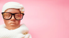 Mannequin With Glasses And A Scarf, Discounts On Winter Clothes And Accessories, On A Pink Background, Banner, Copy Space