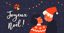 Joyeux Noël Or Merry Christmas In French Language. Happy Couple Wearing Winter Sweaters And Santa Hat. Calligraphic Lettering. Bell, Lamps. Love And Family Concept. Vintage Greeting Card Or Poster.