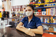 Young Woman Wearing Face Mask Working In Hardware Store
