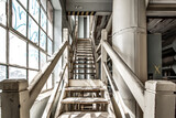 Fototapeta Na drzwi - Abandoned building with industrial spooky stairs