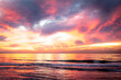 Beach at sunset with colorful sky,