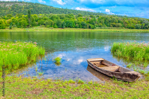 Fototapety, obrazy: Idyllic green scenery with wooden boat . Spectacular riverside nature