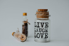 Closeup Shot Of A Jar With The Text Live Laugh Love In A Decoration Set