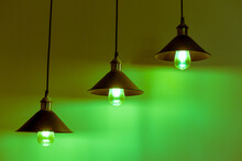 Three Lamps With Vintage Incandescent Bulbs In Green Light