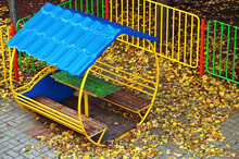 Gazebo On The Playground Covered With Yellow Autumn Leaves