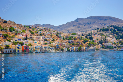Tela View of beautiful bay with colorful houses on the hillside of the island of Symi