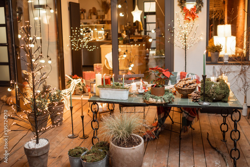 Beautifully decorated backyard of a country house with a festive dinner table during the New Year holidays