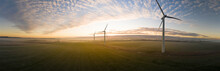 Aerial View Of Three Wind Turbines In The Early Morning Fog At Sunrise In The English Countryside Panorami