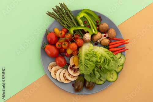 High angle view of freshly cut vegetables on grey plate