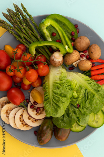 Close up of freshly cut vegetables on grey background