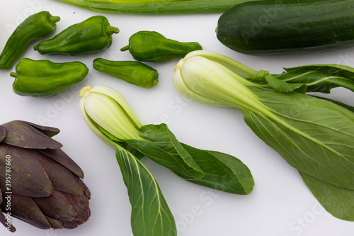 Cucumber, peppers and chicory on white background