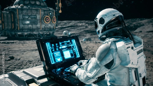Cuadros en Lienzo An astronaut works on his laptop at a space base on one of the new planets