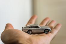 POZNAN, POLAND - Mar 18, 2018: Aston Martin Toy Car On A Hand