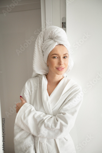 beautiful young woman in a white robe in the interior Wallpaper Mural