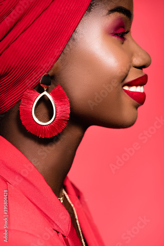 profile of african american young woman in stylish outfit and turban isolated on Wallpaper Mural