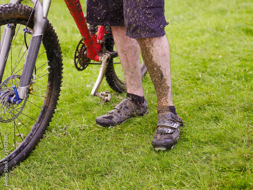 Vászonkép Muddy Cyclist With Bike