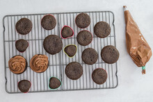 Decorating Chocolate Cupcakes With Chocolate Buttercream Frosting Using A Pastry Bag, Close Up Preparation Process