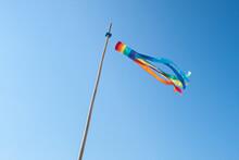Rainbow Wind Sock Fluttering In The Wind
