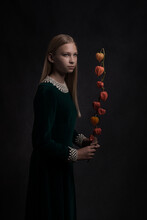 Blonde Girl In Green Classic Dress Holding A Red Lantern  (physialis) Flower In Painterly Portrait