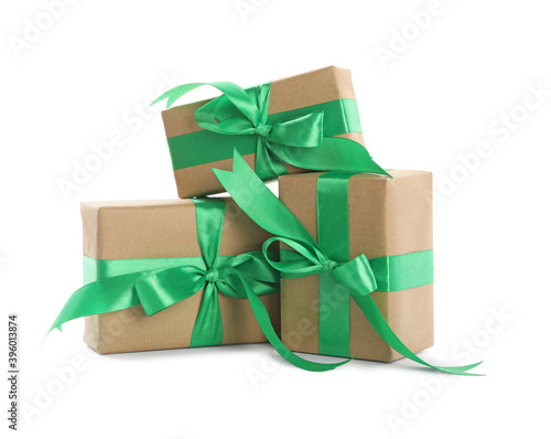 Cuadros en Lienzo Christmas gift boxes decorated with green bows on white background