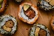 Fresh and gourmet sushi maki rolls filled with wild salmon sashimi