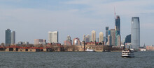 Ellis Island In New York With Hudson River And Skyline
