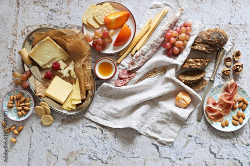 Stampa su Tela Appetizers table with various of cheese, curred meat, sausage, olives, nuts and fruits