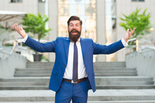 Dressed For Success. Successful Man Celebrate Victory Outdoors. Celebrating Professional Success. Top Achievement. Accomplishment Of Goals. Career Advancement. Promotion At Work. Business Lifestyle
