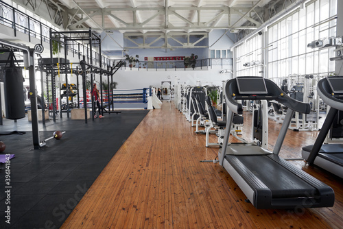 Fototapeta premium Gym interior with equipment. Treadmills for fitness cardio training. Sport club for fitness workout.