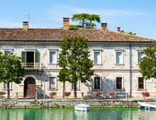 Old Military Building In The City Center. Peschiera Del Garda, Italy. Lake Garda In Summer. Old Italian Buildings